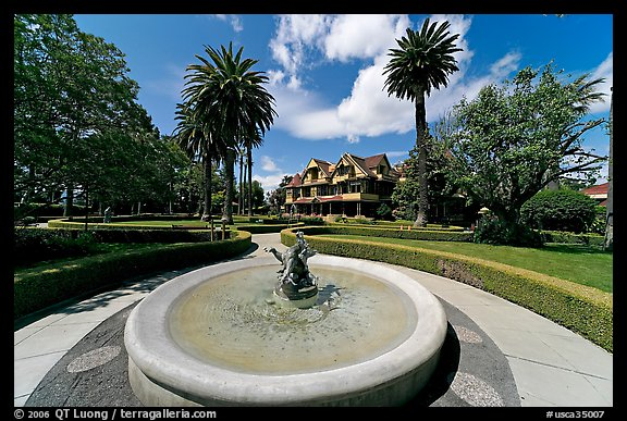 Wide view of fountain, gardens,  and mansion. Winchester Mystery House, San Jose, California, USA (color)