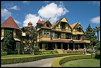 Gardens and facade, morning. Winchester Mystery House, San Jose, California, USA