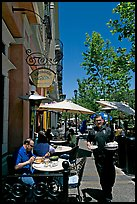 Streetside restaurant terrace and waiter. Santana Row, San Jose, California, USA (color)