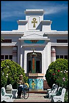 Person walking a bike, Rosicrucian Park. San Jose, California, USA (color)