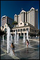 Children, fountain, Plaza de Cesar Chavez  and Fairmont Hotel. San Jose, California, USA (color)