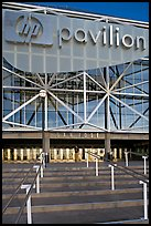 Facade of the HP Pavilion with person walking out. San Jose, California, USA (color)
