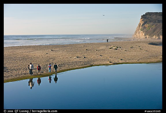 Family walking by lagoon, Scott Creek Beach. California, USA