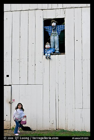 Girl and figures in barn window, Happy Hollow Farm, Rancho San Antonio Park, Los Altos. California, USA