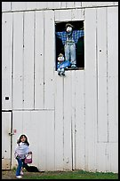 Girl and figures in barn window, Happy Hollow Farm, Rancho San Antonio Park, Los Altos. California, USA (color)