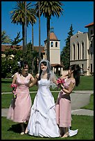 Bride and bridesmaids in front of mission, Santa Clara University. Santa Clara,  California, USA (color)