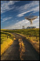Gravel road leading to parabolic antenna, late afternoon. Stanford University, California, USA (color)