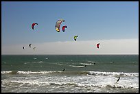 Group of kitesurfers, Waddell Creek Beach. California, USA