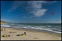 Kitesurfers rolling out sails on on beach, Waddell Creek Beach. California, USA ( color)