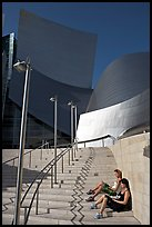 Women sunning on the steps of the entrance of the Walt Disney Concert Hall. Los Angeles, California, USA