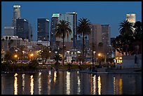Skyline and lights reflected in a lake in Mc Arthur Park. Los Angeles, California, USA