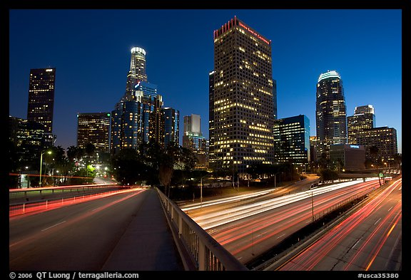 Bridge, Harbor Freeway, and skyline at nightfall. Los Angeles, California, USA