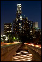 Bridge above Harbor Freeway and US Bank building at night. Los Angeles, California, USA (color)