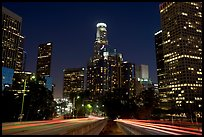Traffic lights and skyline at night. Los Angeles, California, USA
