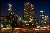 Bridge, traffic lights and Los Angeles skyline at night. Los Angeles, California, USA