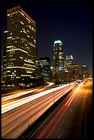 Traffic on Harbor Freeway and skyline at night. Los Angeles, California, USA
