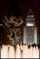 Peace on Earth sculpture, fountain, and City Hall at night. Los Angeles, California, USA