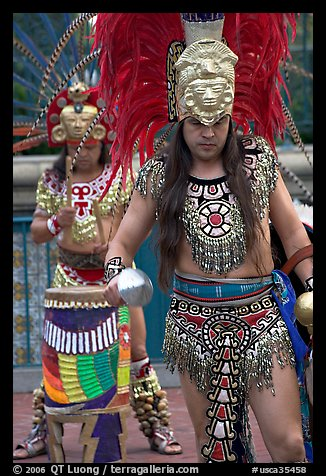 Aztec dancers performing, El Pueblo historic district. Los Angeles, California, USA (color)