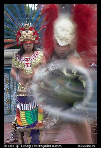 Aztec dancers in motion,  El Pueblo historic district. Los Angeles, California, USA (color)