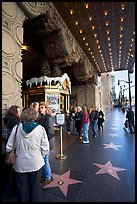 Stars of the Walk of fame in front of the  El Capitan Theatre. Hollywood, Los Angeles, California, USA (color)