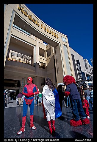 People dressed as movie characters in front of the Kodak Theatre. Hollywood, Los Angeles, California, USA (color)