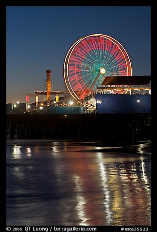 Ferris Wheel in motion at nightfall. Santa Monica, Los Angeles, California, USA (color)
