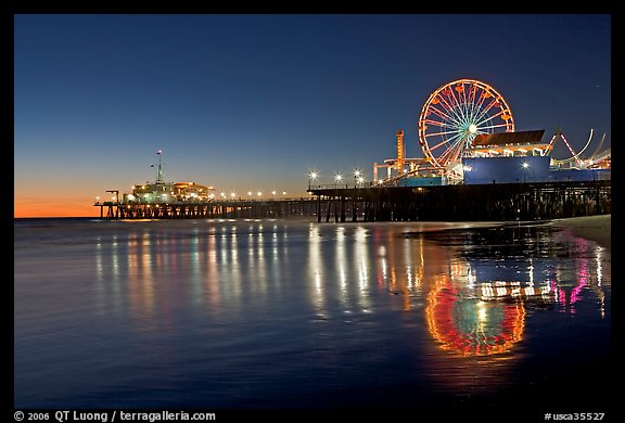 Pier, Ferris Wheel, and reflections  at dusk. Santa Monica, Los Angeles, California, USA