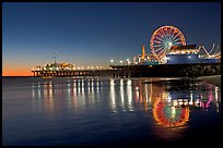 Pier, Ferris Wheel, and reflections  at dusk. Santa Monica, Los Angeles, California, USA (color)