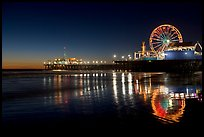 Ferris Wheel and pier reflected on wet sand at night. Santa Monica, Los Angeles, California, USA ( color)