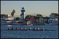 Women Rowers and lighthouse, early morning. Marina Del Rey, Los Angeles, California, USA