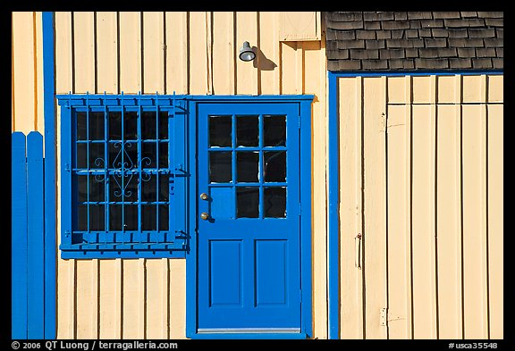 Facade of house with blue doors and windows. Marina Del Rey, Los Angeles, California, USA