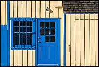 Facade of house with blue doors and windows. Marina Del Rey, Los Angeles, California, USA (color)