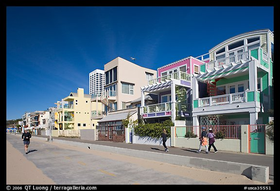People jogging and strolling on beach promenade. Santa Monica, Los Angeles, California, USA (color)