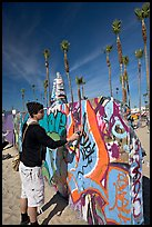 Young man making graffiti on a wall. Venice, Los Angeles, California, USA (color)