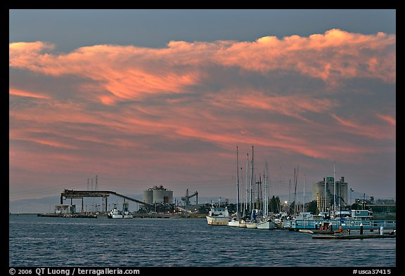Yachts and industrial installations, port of Redwood, sunset. Redwood City,  California, USA