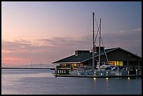 Marina building and yachts, sunset. Redwood City,  California, USA