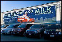 Historic advertising mural, in a car dealership lot. Burlingame,  California, USA (color)