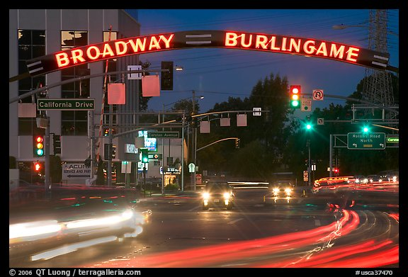 Broadway at night with lights from moving cars. Burlingame,  California, USA (color)
