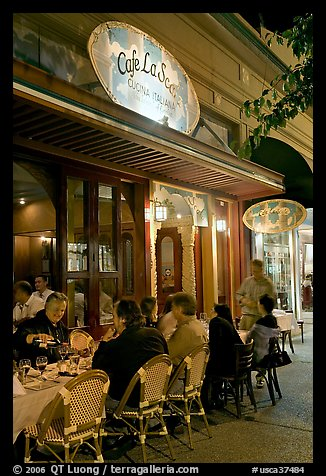 Italian restaurant with diners by night. Burlingame,  California, USA (color)