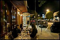 Sidewalk with Outdoor restaurant table and people walking. Burlingame,  California, USA (color)