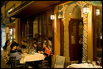 Outdoor table of Italian restaurant at night. Burlingame,  California, USA (color)