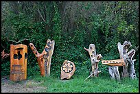 Wood carvings in garden. Half Moon Bay, California, USA (color)