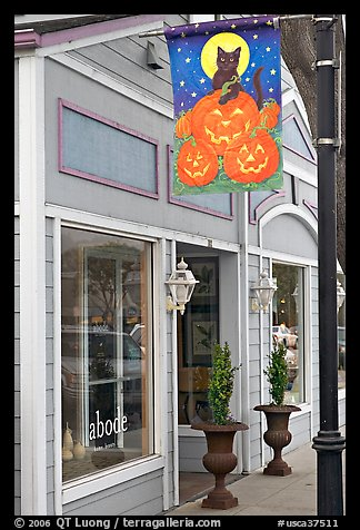Storefront on Main Street with Halloween street decor. Half Moon Bay, California, USA (color)
