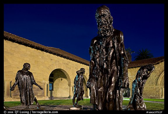 Rodin Burghers of Calais in the Main Quad at night. Stanford University, California, USA (color)