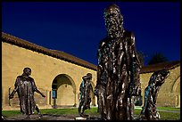 Rodin Burghers of Calais in the Main Quad at night. Stanford University, California, USA