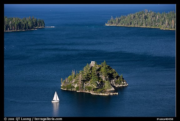 Mouth of Emerald Bay, Fannette Island, and sailboat, Lake Tahoe, California. USA