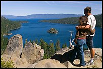 Couple standing above Emerald Bay, Lake Tahoe, California. USA