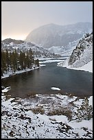 Early spring snow on Ellery Lake, sunrise. California, USA