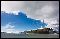 Golden Gate Bridge and Alcatraz under large cloud. San Francisco, California, USA ( color)