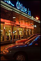 Neon lights of Mels drive-in reflected on parked cars. San Francisco, California, USA (color)